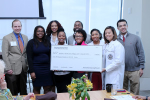 Students of Meharry Medical College Class of 2016 accept a $1,000 check from Ken Youngstead (far left) on behalf of NOW Diversity.
